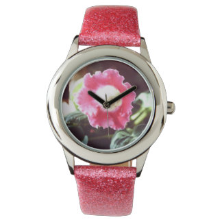 Watch with pink band and pink primrose blossom.