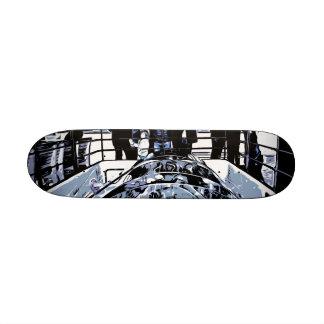 Watching machinery in operation skateboard deck