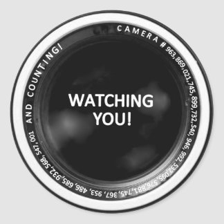 """WATCHING YOU!"" CAMERA LENS WALL STICKER"