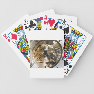Watchmaker clock working bicycle playing cards