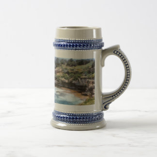 Water cove with rocky cliffs beer stein