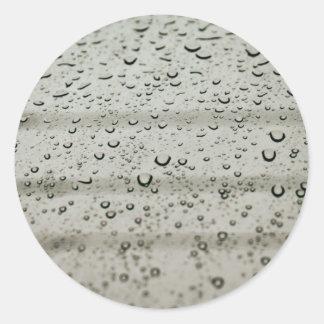 Water drop on a window classic round sticker