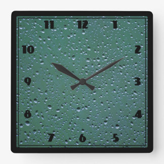 Water Droplets on a Green Background Square Wall Clock