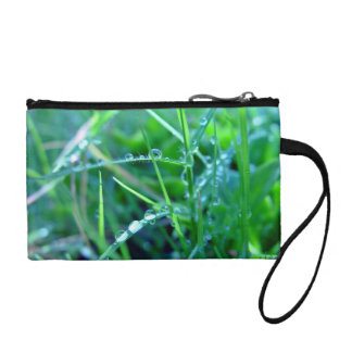 Water droplets on grass coin wallet