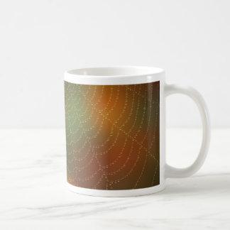 Water drops on a spider web coffee mug