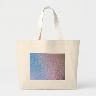 Water drops on blue and pink surface large tote bag