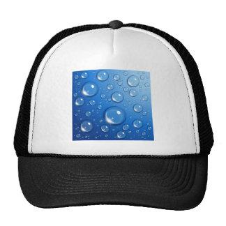 Water drops on blue trucker hat