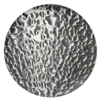 water drops on brushed metal plate
