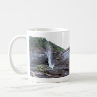 Water errupting from blow hole mug