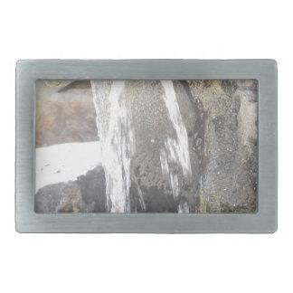 Water falling down over the rocks rectangular belt buckle