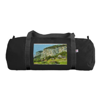 Water falling off a cliff duffle bag