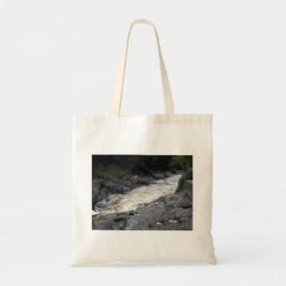 Water flowing through the rocks budget tote bag