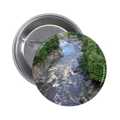 Water flowing through the rocks button