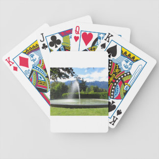 Water fountain with mountain background bicycle playing cards