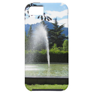 Water fountain with mountain background iPhone 5 covers