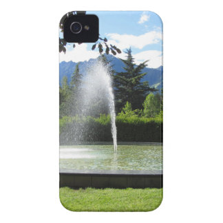 Water fountain with mountain background iPhone 4 covers