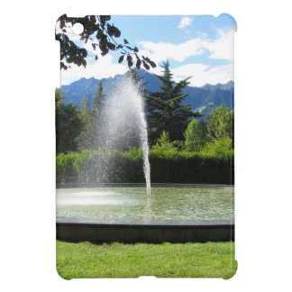 Water fountain with mountain background iPad mini covers