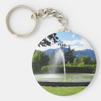 Water fountain with mountain background keychain
