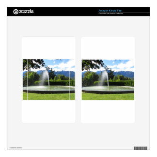 Water fountain with mountain background kindle fire skins