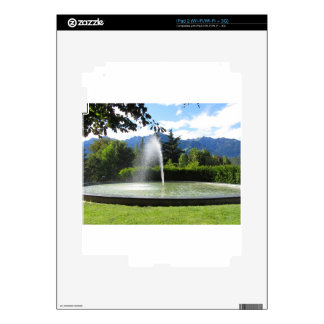 Water fountain with mountain background iPad 2 skin