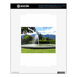 Water fountain with mountain background skin for the NOOK