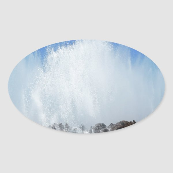 Water hitting rocks on canary islands oval sticker
