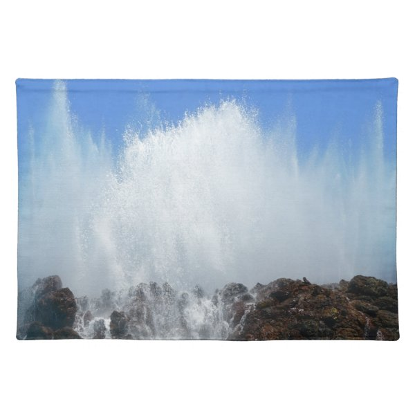 Water hitting rocks on canary islands placemat