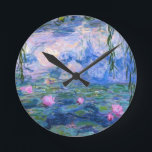 """Water Lilies 1 Round Clock<br><div class=""""desc"""">Water Lilies is a series of more than 200 oil paintings by French Impressionist Claude Monet (1840–1926). The paintings which are on display in museums around the world, depict Monet&#39;s flower garden at Giverny. During the last 30 years of his life, these paintings were Monet&#39;s main focus, many of which...</div>"""