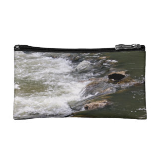 Water of the Guadiaro river between jumping betwee Cosmetic Bag