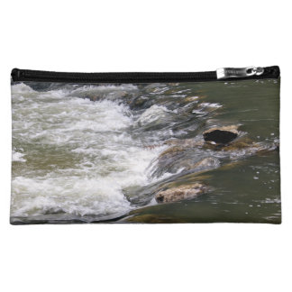 Water of the Guadiaro river between jumping betwee Makeup Bag