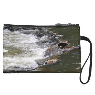 Water of the Guadiaro river between jumping betwee Suede Wristlet Wallet