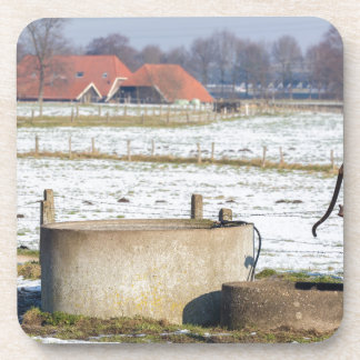 Water pump and well in winter snow landscape drink coaster