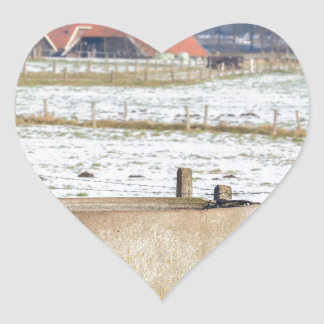 Water pump and well in winter snow landscape heart sticker