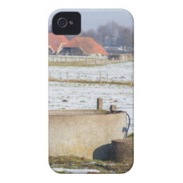 Water pump and well in winter snow landscape iPhone 4 cover