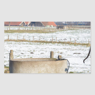 Water pump and well in winter snow landscape rectangular sticker