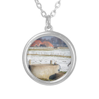 Water pump and well in winter snow landscape silver plated necklace