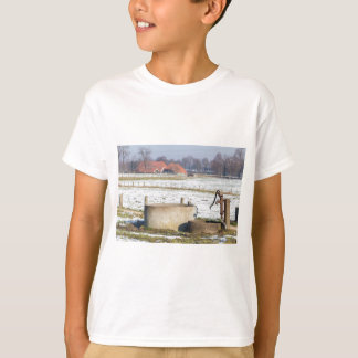 Water pump and well in winter snow landscape T-Shirt