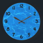 "Water Ripples Pattern Large Clock<br><div class=""desc"">A Digitalbcon Images Design featuring a blue color and water ripples design theme in this one-of-a-kind &quot;Water Ripples Pattern.&quot;  Make a big splash this summer with this eye-catching design. This summer&#39;s hottest attraction is so cool it&#39;ll have all your friends wanting one too!!</div>"