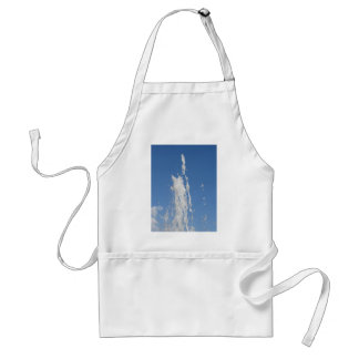 Water spraying from a fountain against the blue sk adult apron