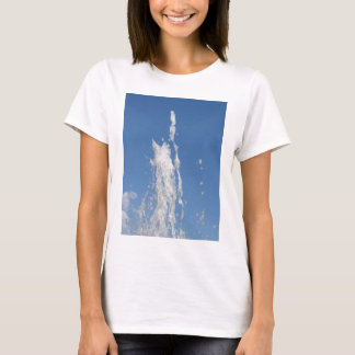 Water spraying from a fountain against the blue sk T-Shirt