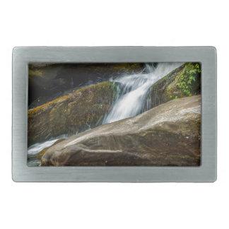 water stream flowing through mountain river rocks belt buckle