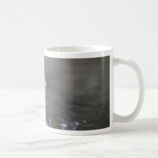 Water stream on  a well coffee mug