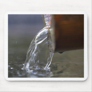 Water stream on  a well mouse pad