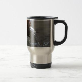 Water stream on  a well travel mug