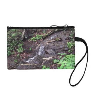 Water stream through trees coin purse