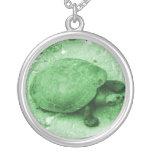 water turtle on bank green reptile pendants