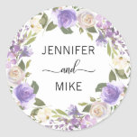 """Watercolor Floral Wreath Lavender Lilac Wedding Classic Round Sticker<br><div class=""""desc"""">Lovely calligraphy script thank you wedding, marriage stickers / seals to add to your envelopes, invitations, cards and/or gifts favors. Lavender, lilac, purple, violet, pink, beige, wreath watercolor flowers on white background. BACKGROUND COLOR CAN BE CHANGED. Perfect for any springtime, spring or summer theme wedding - matches any wedding hue...</div>"""
