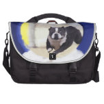 Watercolor painting of a Boston Terrier jumping Commuter Bags