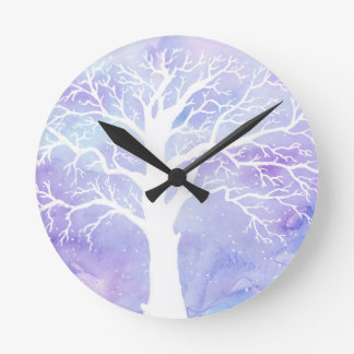 Watercolor winter tree in snow round clock