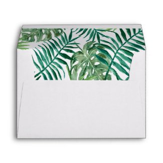 Watercolored green palm tree leaves and foliage envelope